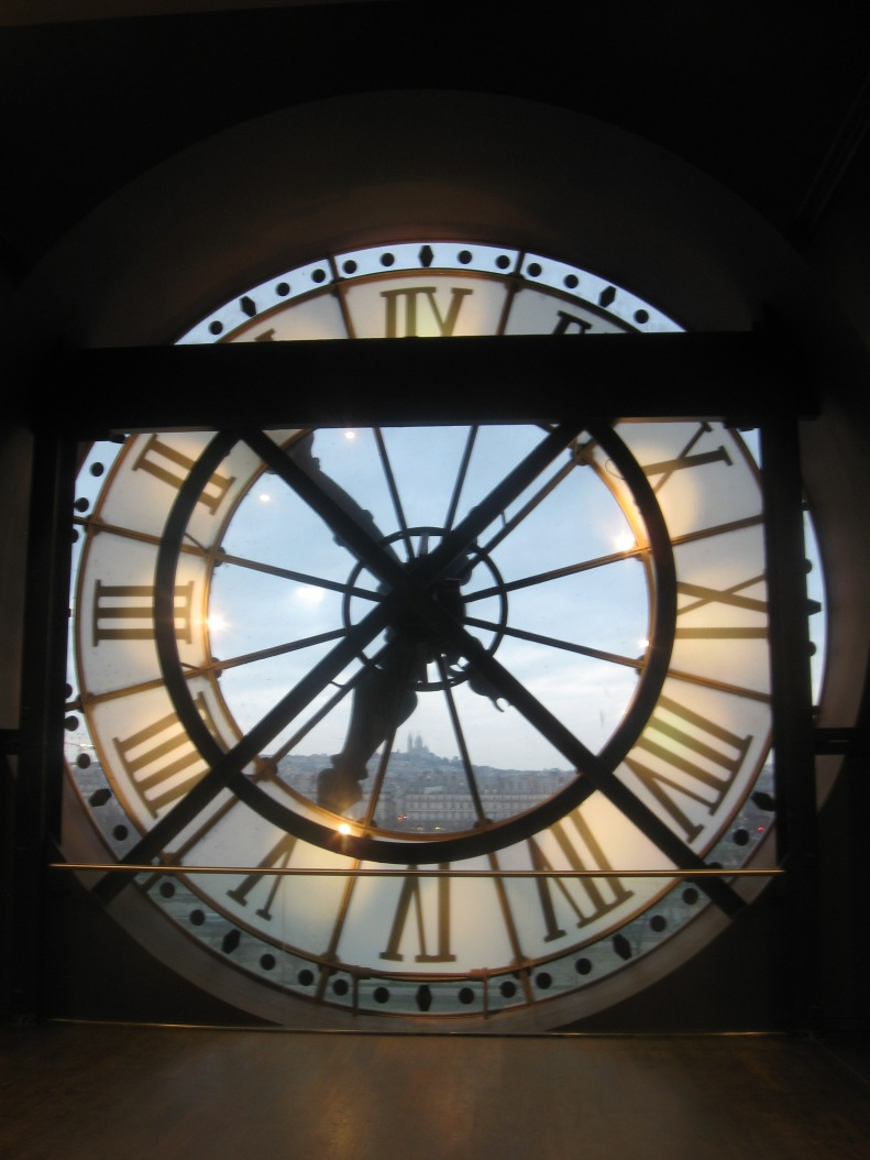 There are huge clock faces on the front of the museum, and from the top floors you can also take a peek out from behind them. It was later in the day and the sun was just right.....I love this shot. If you squint closely at 6 o'clock you can just see Sacre Couer on the horizon.